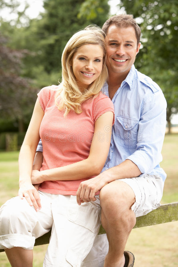 Download Couple Relaxing In Countryside Sitting On Fence Stock Image - Image: 15555941