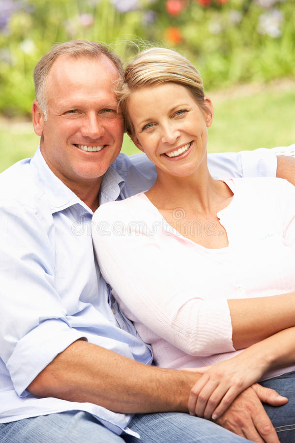 Download Couple Relaxing In Garden stock image. Image of outdoors - 15082513