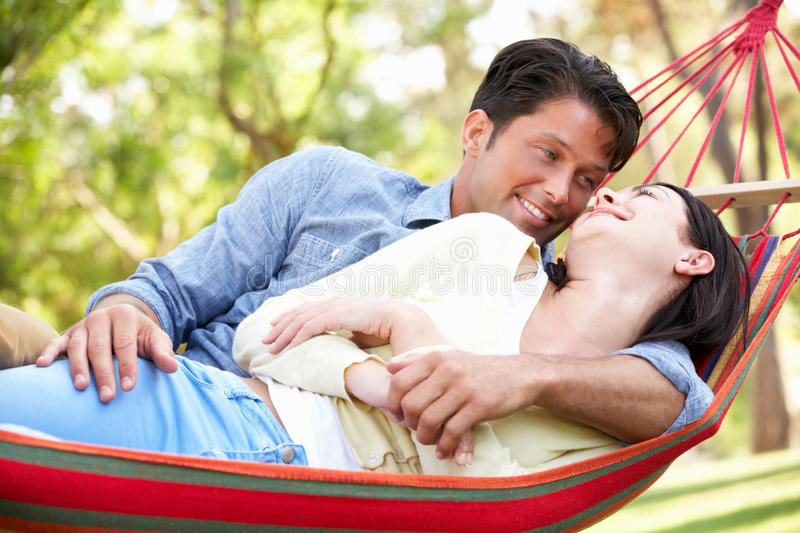 Download Couple Relaxing In Hammock Royalty Free Stock Photos - Image: 27703348