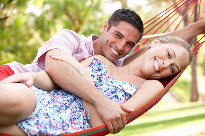 Download Couple Relaxing In Hammock stock image. Image of looking - 27703529