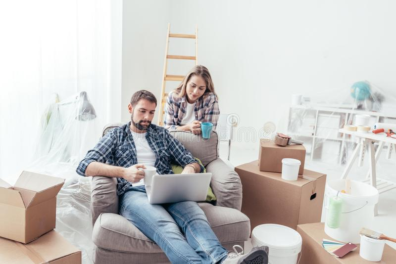 Couple relaxing during home renovation stock images