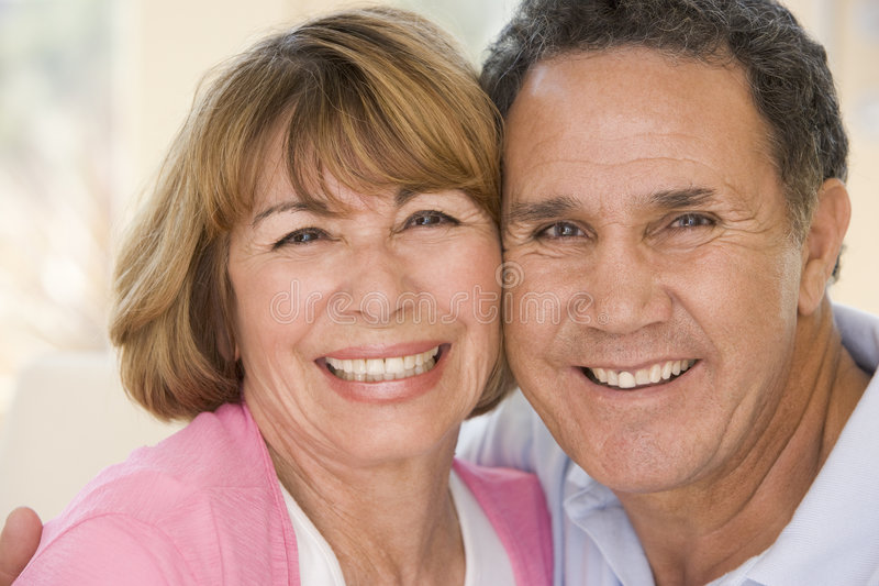 Couple relaxing in living room smiling royalty free stock photos