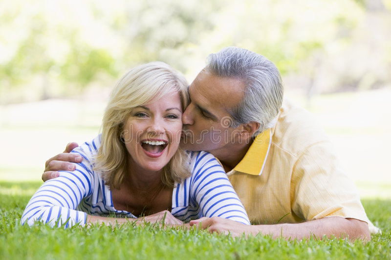 Download Couple Relaxing Outdoors In Park Kissing Stock Photo - Image: 5537278