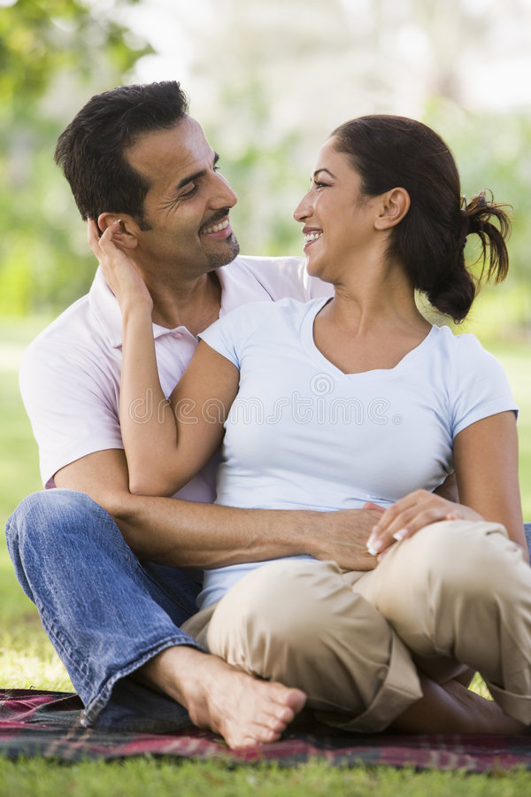 Download Couple relaxing in park stock photo. Image of together - 5208862