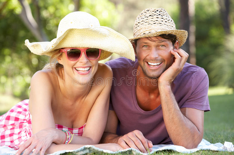 Download Couple Relaxing In Park Together Royalty Free Stock Photo - Image: 27274895