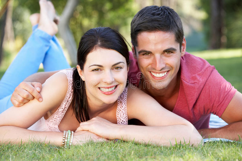 Download Couple Relaxing In Park Together Stock Photo - Image: 27274946