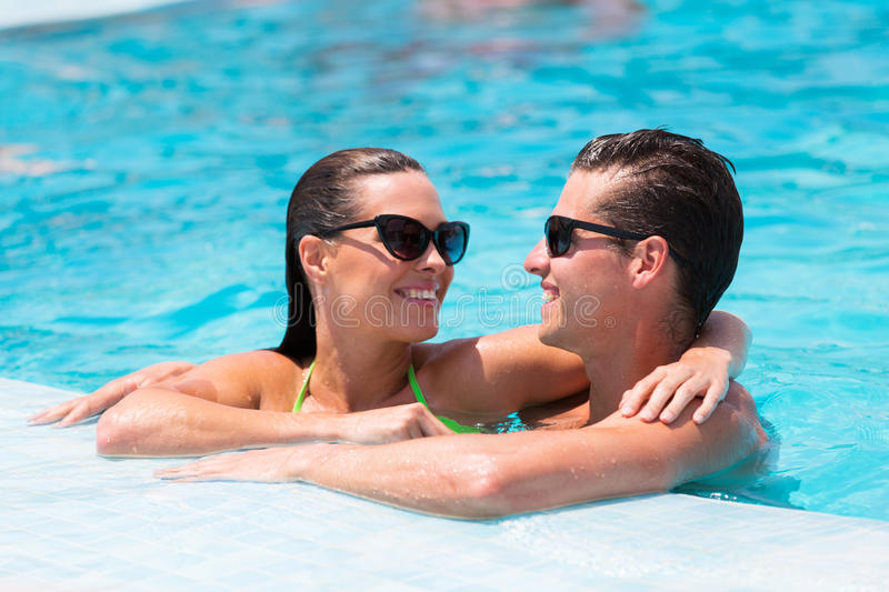 Couple relaxing pool stock photography