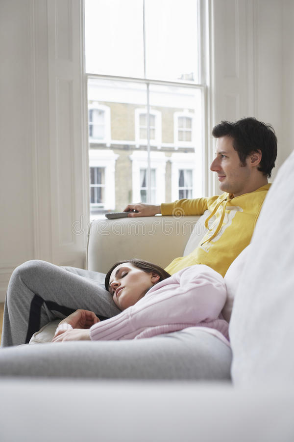 Download Couple Relaxing On Sofa stock photo. Image of program - 33847320