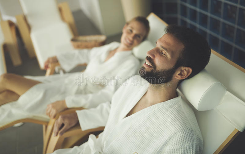 Couple relaxing in spa center. Beautiful couple relaxing in spa center royalty free stock image