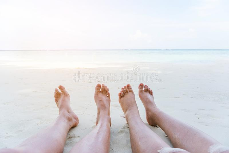 Couple relaxing in summer holiday on beach stock image