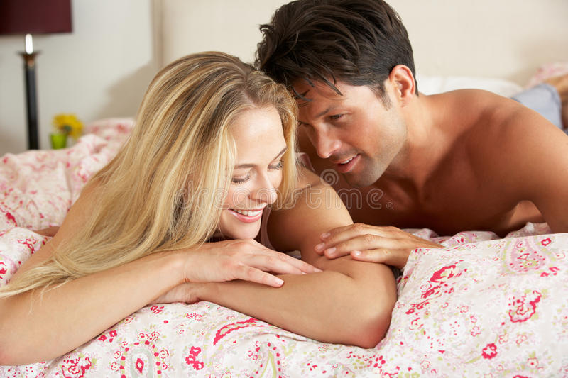 Download Couple Relaxing Together In Bed Stock Photo - Image: 26616088