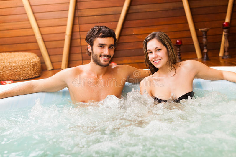 Couple relaxing in a whirlpool. Smiling couple relaxing in a whirlpool royalty free stock photography