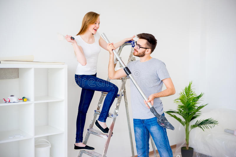 Couple renovating apartment. Young couple renovating their new house together royalty free stock photos