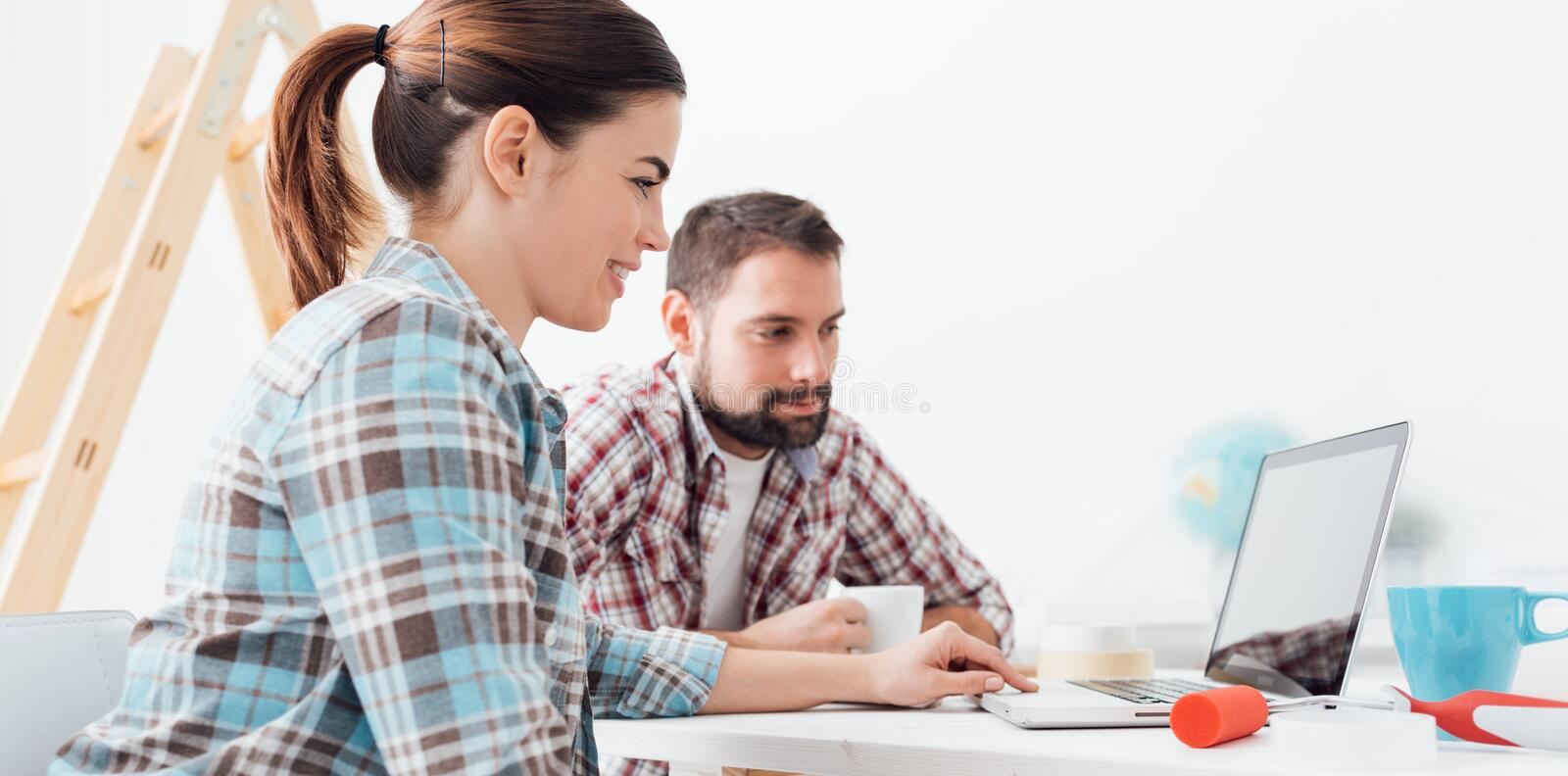 Couple renovating their home royalty free stock image