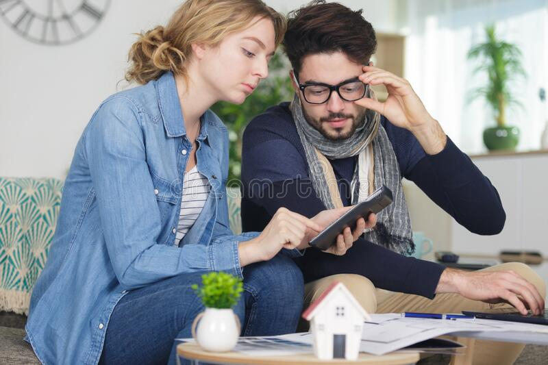 Couple researching housing possibilities on tablet stock photography