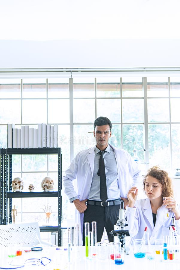 The Couple reserchers, scientists, technicians, dentists or students conducting research or experiment or diagnose stock photography