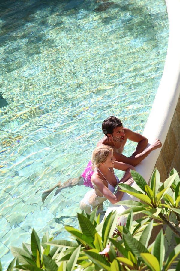 Couple in resort pool