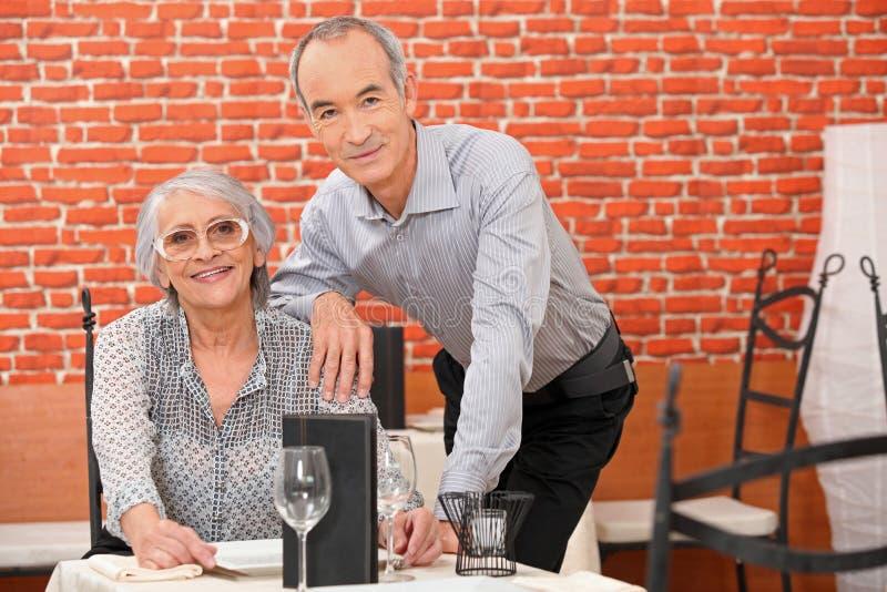 Couple in a restaurant stock photos
