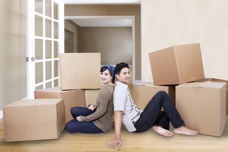 Couple resting at new home. Young couple resting from moving into a new home royalty free stock images