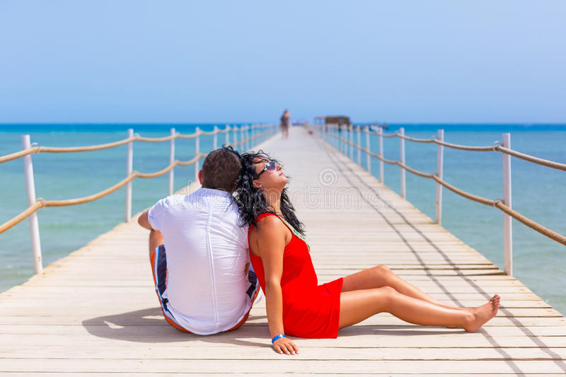 Download Couple Resting On The Pier Of Red Sea Stock Photo - Image: 30648494