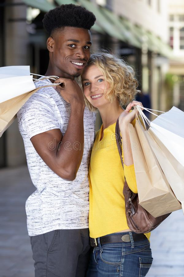 Couple resting after shopping royalty free stock image