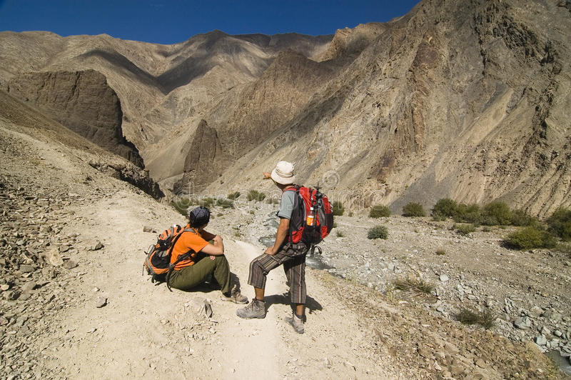A couple resting during a trek in Markha Valley royalty free stock photography