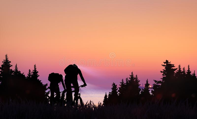 A couple ride bicycles on sunset in forest. Couple ride bicycles on sunset along sea coast royalty free stock photography