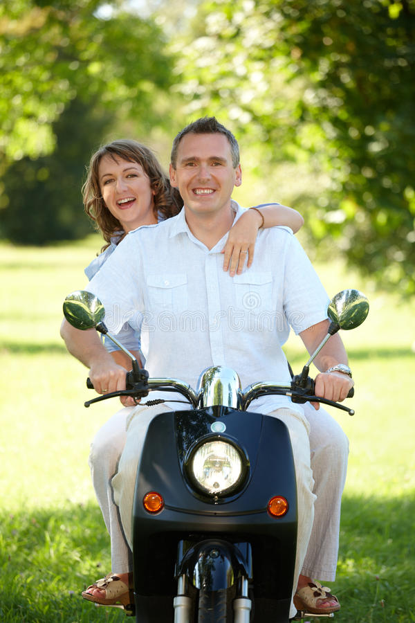 Download Couple riding stock photo. Image of handsome, outside - 21975434