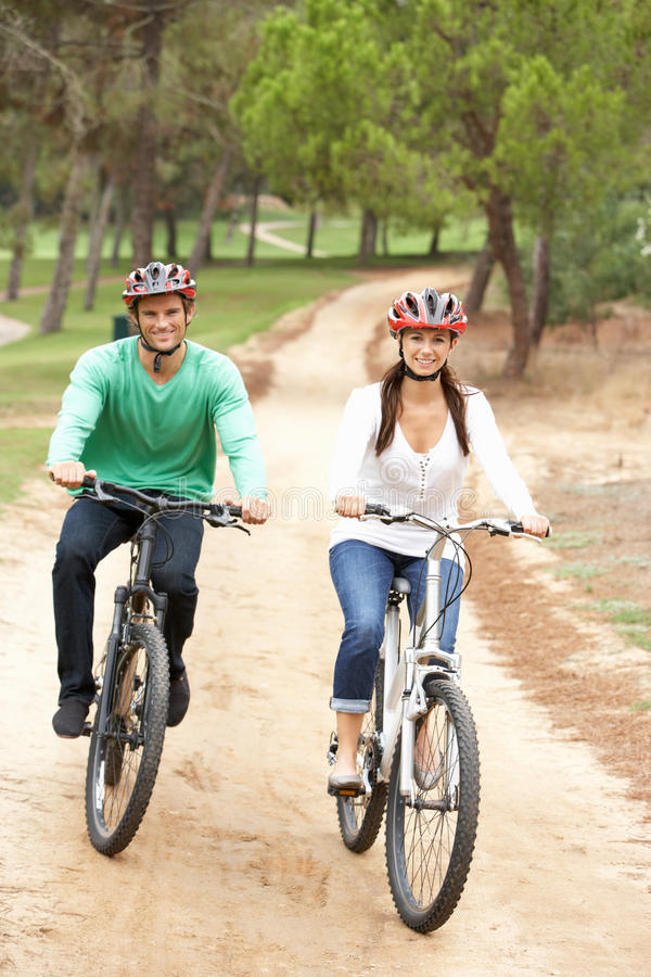 Download Couple Riding Bicycle In Park Stock Photo - Image: 16826098