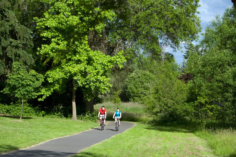Download Couple Riding A Bike - Horizontal Stock Image - Image: 5698297
