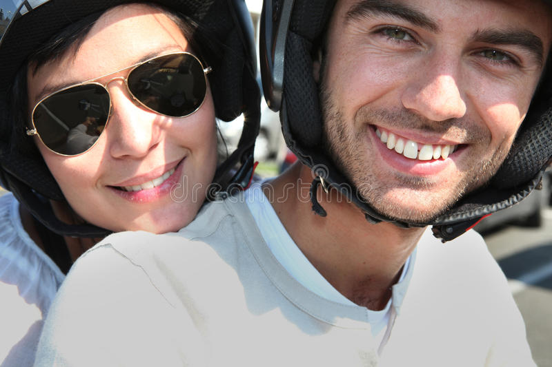 Download Couple Riding Their Scooter Stock Image - Image: 24160701
