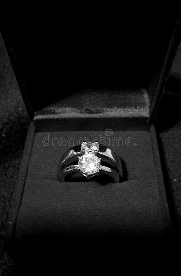Couple rings; Diamond Engagement ring stock photography