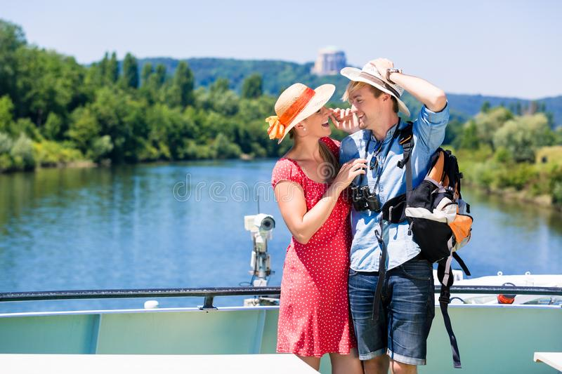 Couple on river cruise wearing sun hats in summer royalty free stock photo