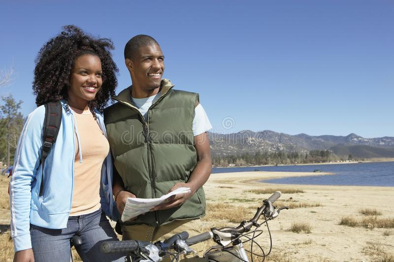 Couple With Roadmap Looking Away stock image