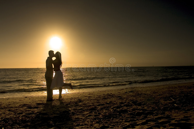 Couple in a Romantic Afternoon. Couple kissing at the beach
