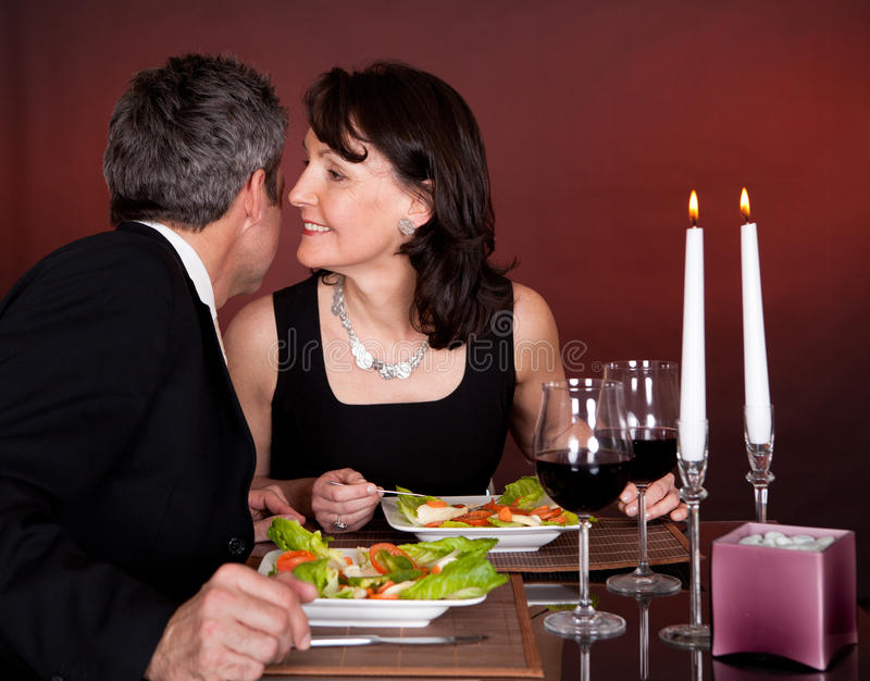 Couple at romantic dinner in restaurant. Mature couple having romantic dinner in restaurant stock photography