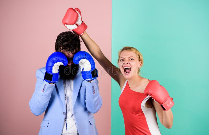 Couple romantic relationships. Man and woman boxing fight. Boxers fighting gloves. Difficult relationships. Couple in stock photography