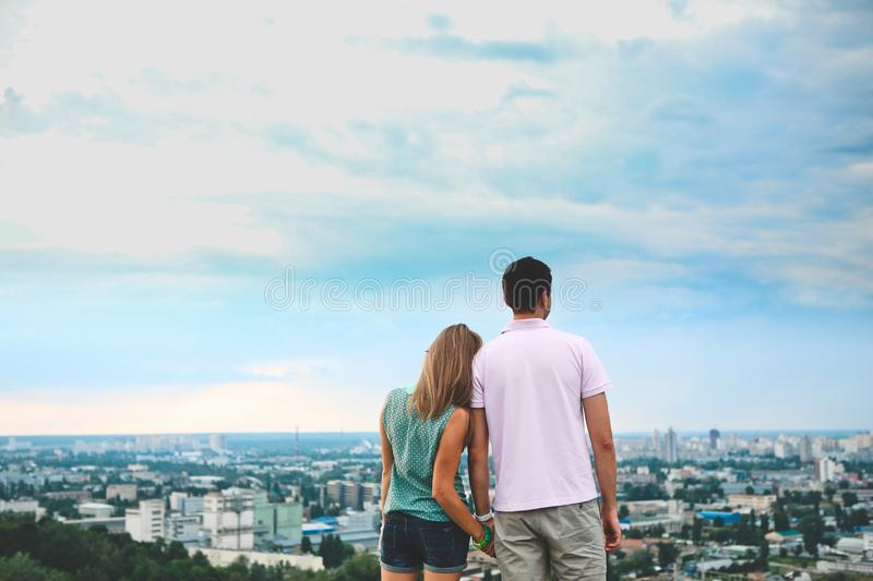 Couple roof backside holding hands looking city royalty free stock photos