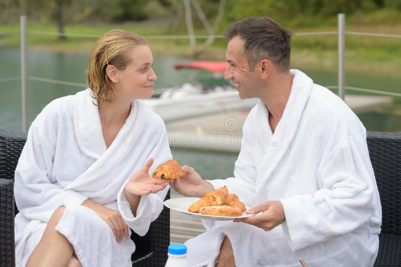 Couple in roof top restaurant with view to lake royalty free stock photos