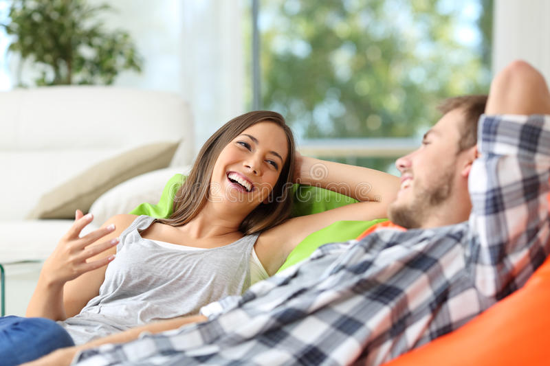 Couple or roommates talking at home stock photography