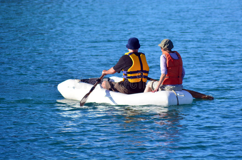 Couple rows dinghy boat. Couple rows a rubber inflatable dinghy boat royalty free stock image