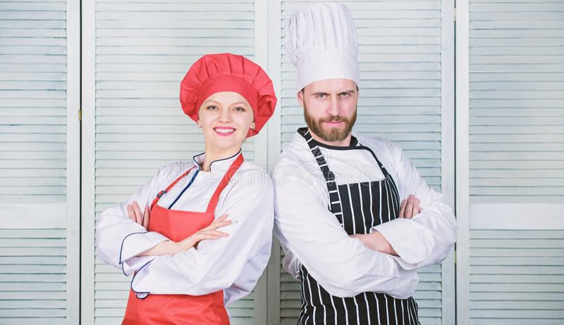 Couple ruling the culinary world. Family cooking in kitchen. man and woman chef. secret ingredient by recipe. cook. Couple ruling the culinary world. Family royalty free stock photography
