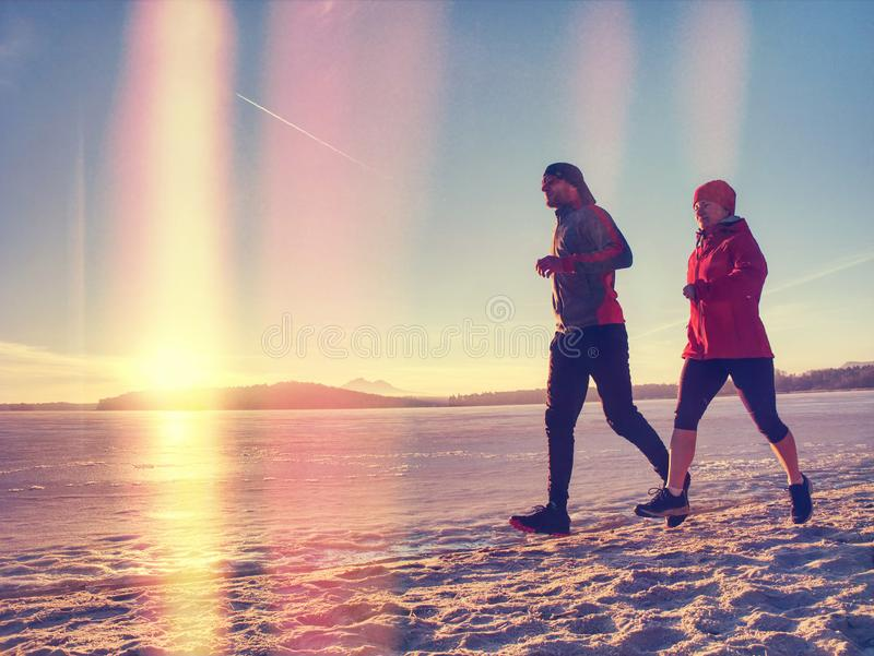 Couple runners running in winter nature stock photography