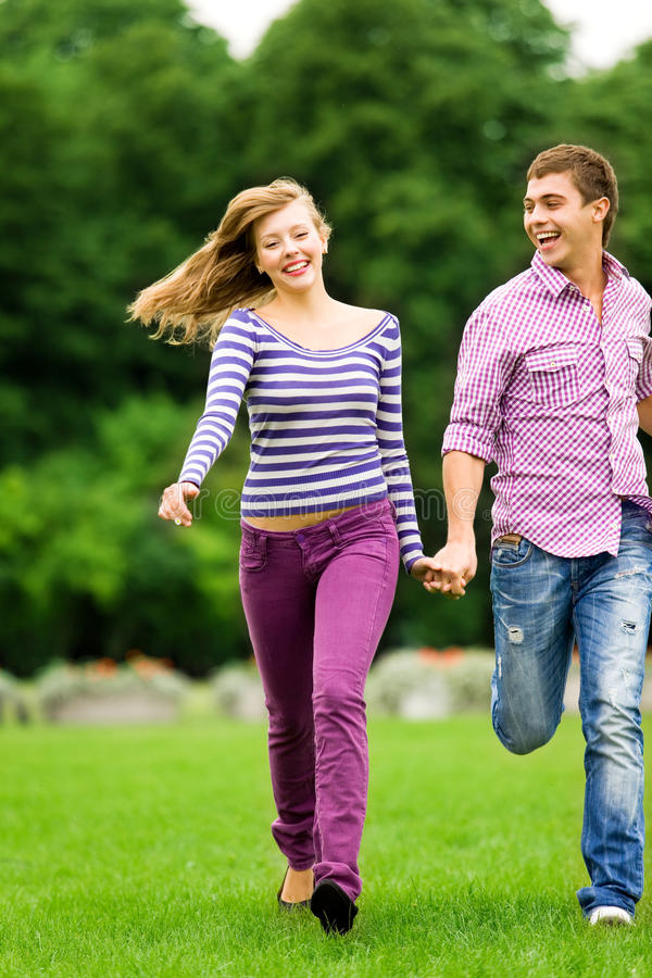Couple running royalty free stock image