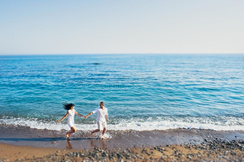 Couple in love having fun on the beach royalty free stock photography