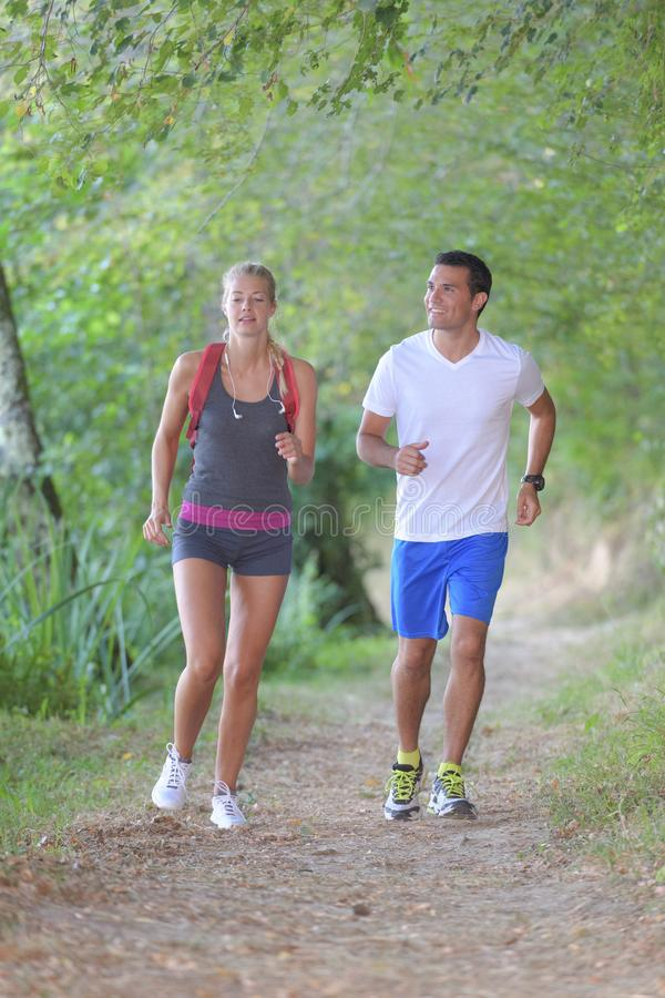 Couple running in forest stock images