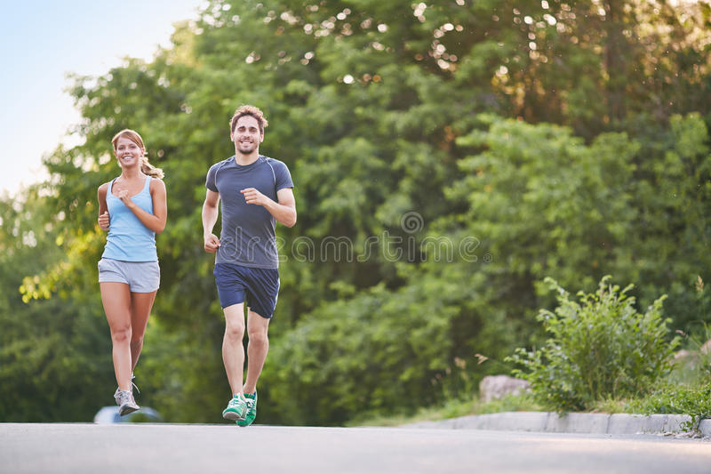 Couple running royalty free stock photo