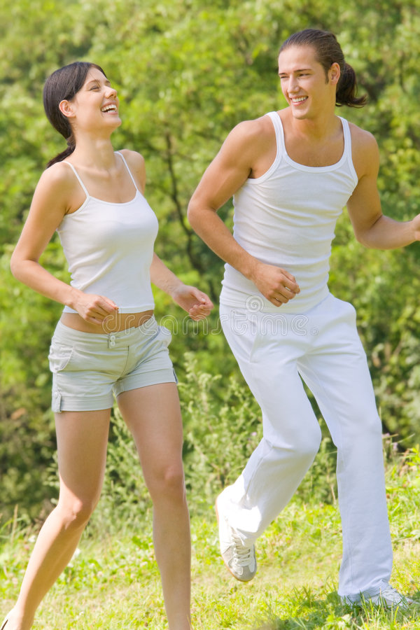 Download Couple running together stock photo. Image of laugh, lifestyle - 5936134