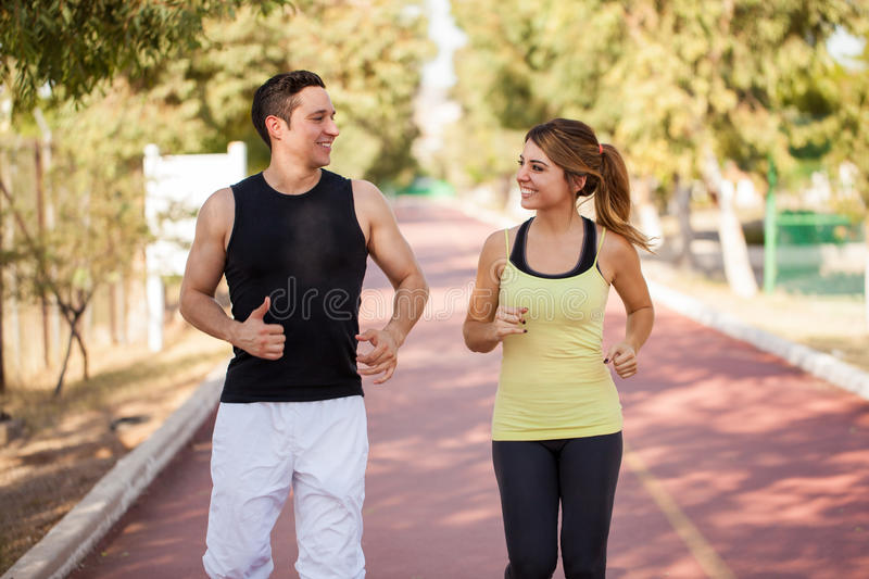 Couple running together outdoors royalty free stock image