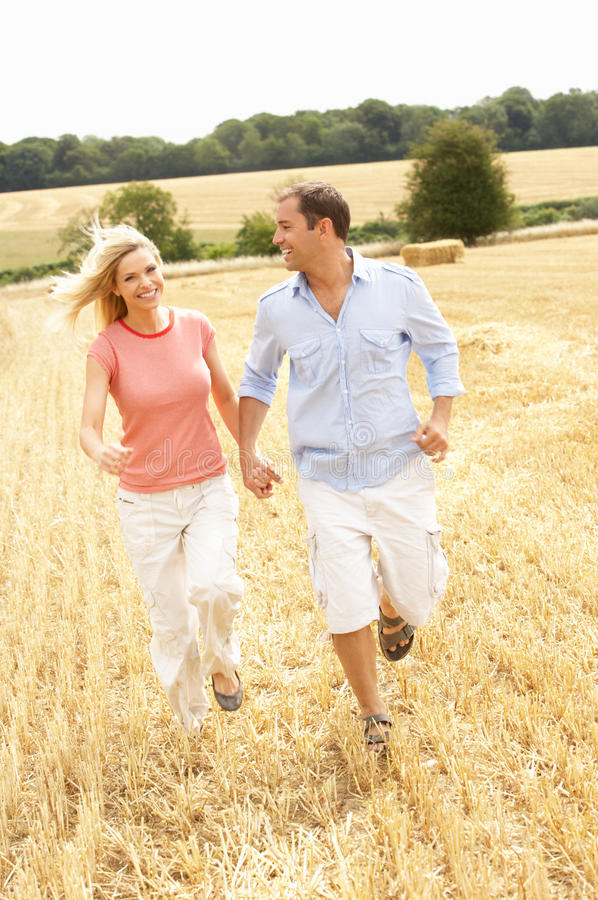Download Couple Running Together Through Summer Harvested F Stock Image - Image: 15554003